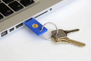 The YubiKey is a small USB and NFC device supporting multiple authentication and cryptographic protocols.